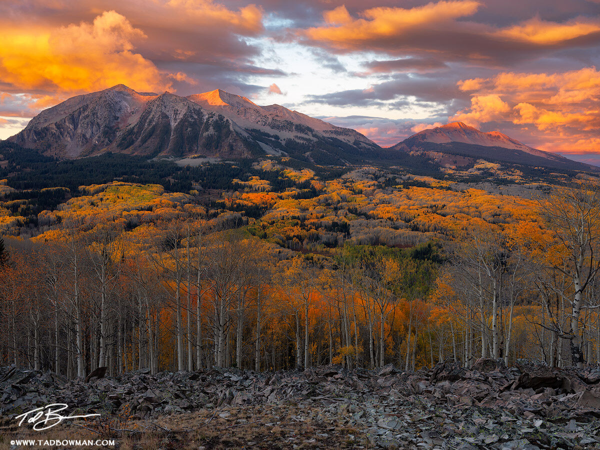 This Colorado mountain picture depicts a colorful autumn sunrise on the Beckwith Mountains in the Gunnison National Forest with...