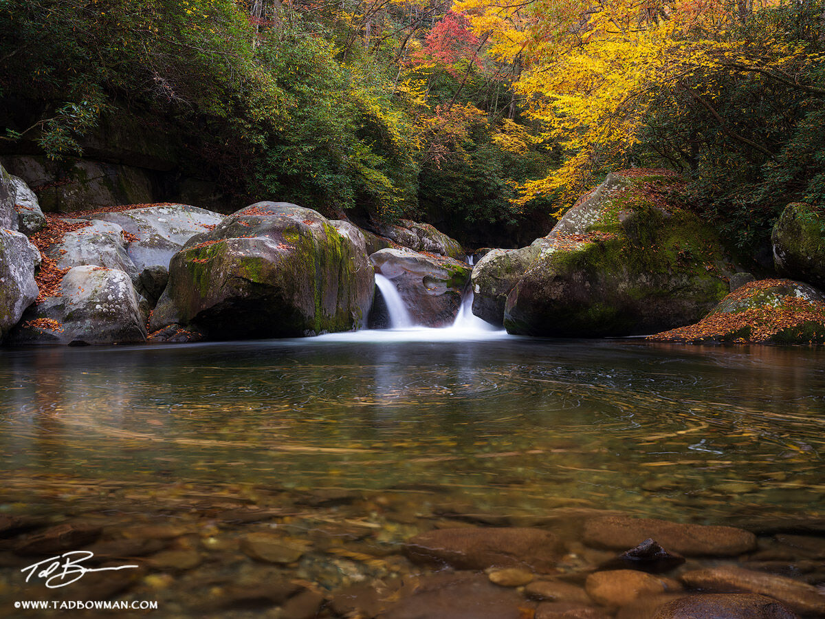 This Smoky Mountains photo depicts an area called 'Midnight Hole' with fall foliage surrounding it