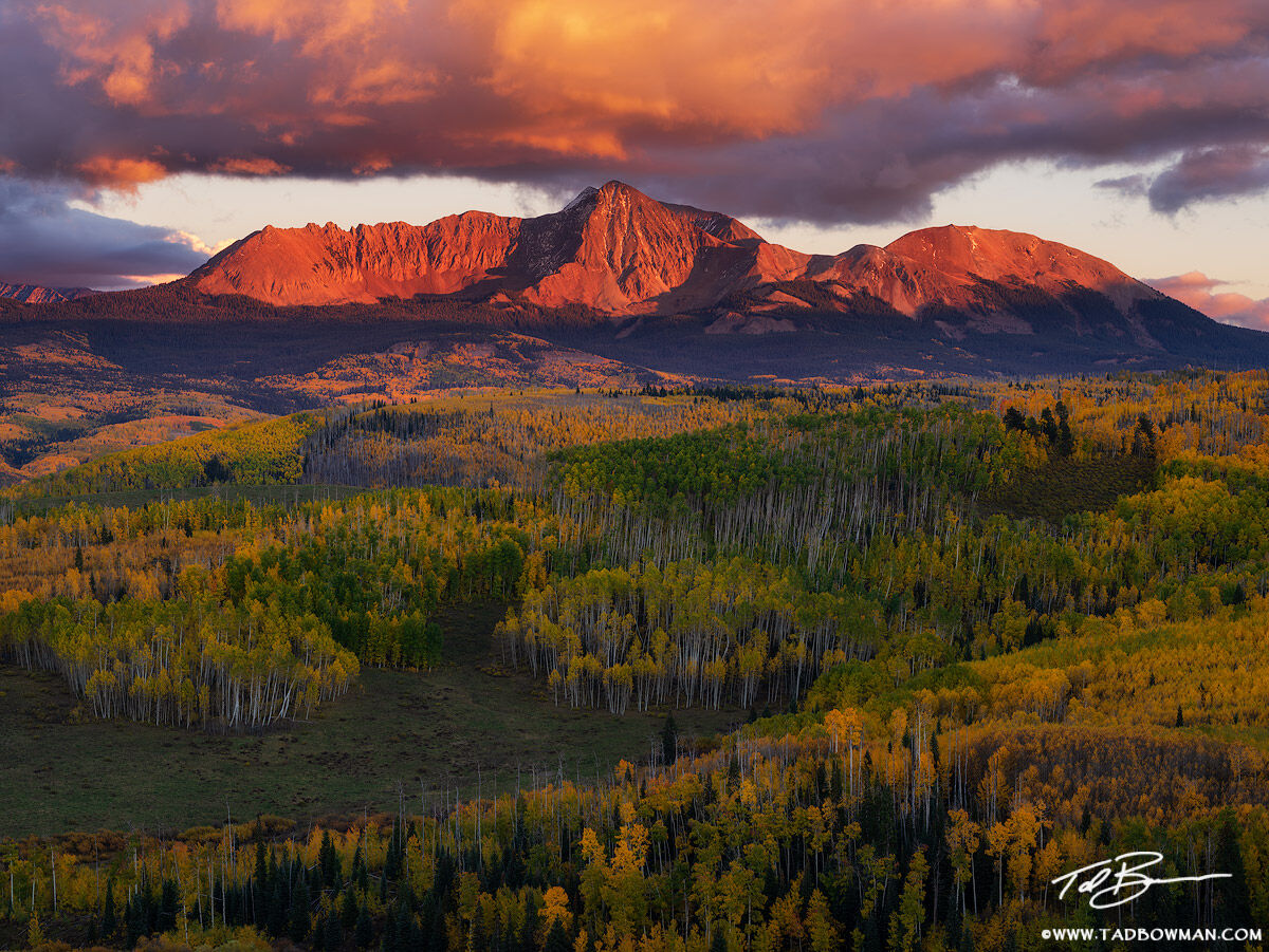 This Colorado mountain photo depicts the San Miguel Mountains with rich warm colors at sunset with colorful fall foliage in the...