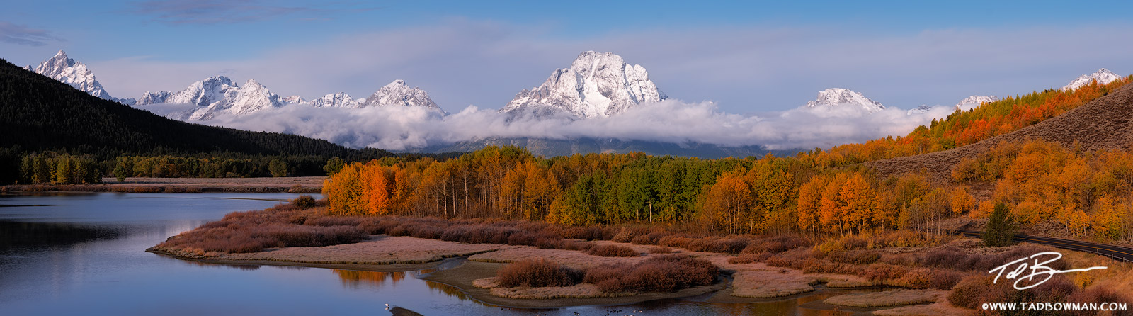 This Wyoming fall photo depicts a snowy Grand Teton morning with colorful fall foliage situated at Oxbow Bend