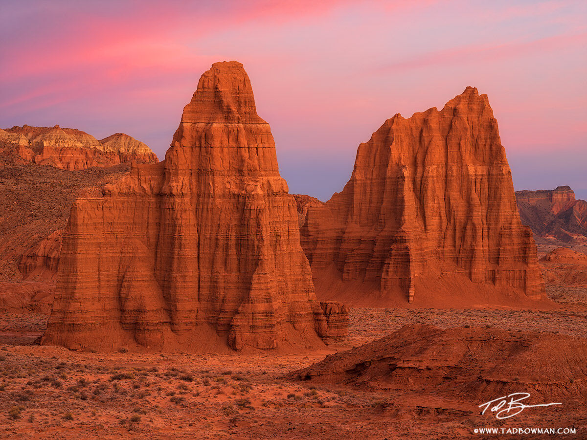 This Utah photo depicts sandstone formations Temple of the Sun and Moon at Sunrise in the Cathedral Valley situated in the Capitol...